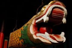 träbuddistisk kinesisk fisk Arkivbild