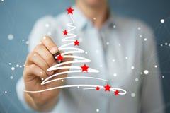 Träd för affärskvinnateckningsjul skissar Royaltyfria Foton