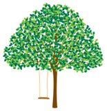 Träd i sommar med gunga Arkivbilder