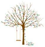 Träd i vinter med julljus Arkivbild