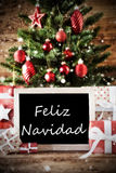 Träd med Feliz Navidad Means Merry Christmas Arkivbilder