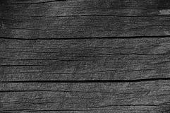 Trädetalj för plankabrädeGrey Black Wood Tar Paint textur, stor gammal åldrig mörk Gray Detailed Cracked Timber Rustic makroClose Arkivfoto