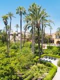 Trädgårdar av alcazaren av Seville, Spanien Arkivfoto