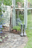 Trädgårds- hjälpmedel och Wellington Boots Royaltyfria Bilder