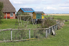 Trädgårds- idyll på Hallig Groede Arkivbilder
