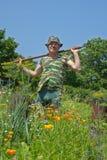 Trädgårdsmästare med hacka 11 Royaltyfria Bilder