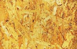 Träflismaterial i varma färger arkivfoton