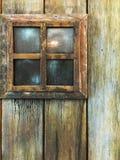 trägammalt fönster Royaltyfria Foton