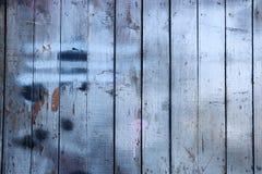 Trägaragedörrtextur arkivfoto