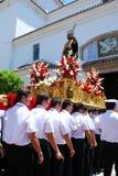 Träger, die Karnevalsfloss, Marbella tragen Lizenzfreie Stockbilder
