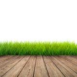 Trägolv med grönt gräs arkivfoton