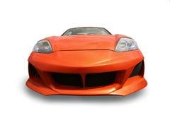 Trägt das orange lokalisierte Auto zur Schau Stockfotos