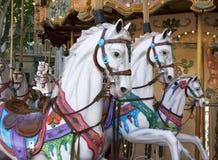 Trähästar i en caroussel royaltyfri fotografi