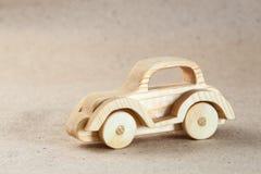 Trähandgjord leksak - retro bil Royaltyfria Bilder