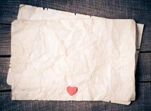 Trähjärta på gammalt papper Royaltyfri Foto