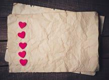 Trähjärta på gammalt papper Fotografering för Bildbyråer