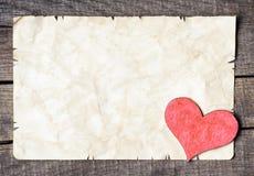 Trähjärta på gammalt papper Arkivbild