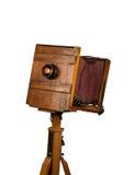 Träklassisk retro kamera på tripoden Arkivbild