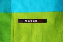 Träkub med namnet av månaden marsch Royaltyfri Bild