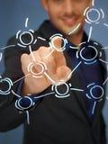 Trängande knapp för affärsman med kontakten Arkivfoto