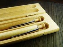 Träpennor på träbakgrund Fotografering för Bildbyråer
