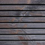 Träplankaterrassbräde, svart, Grey Wood Tar Paint Texture detalj, stora gamla åldriga mörka Gray Detailed Cracked Timber Rustic Arkivfoto