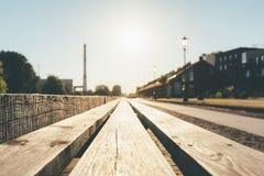 Träplankor med bygdbakgrund på soluppgång fotografering för bildbyråer