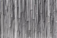 Träplankor som bygger väggbakgrund arkivfoto