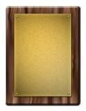 Träplatta med den guld- plattan Fotografering för Bildbyråer