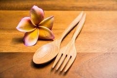 Träskedar och gaffel Arkivfoto