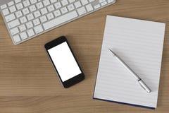 Träskrivbordtangentbordsmartphone och notepad Fotografering för Bildbyråer