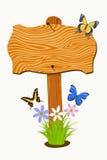 Träskylt med blommor och fjärilar Fotografering för Bildbyråer