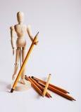 Träskyltdocka för att måla med blyertspennor på a Royaltyfria Foton