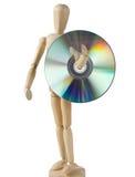 Träskyltdocka som bär en kompakt Disk Arkivbild