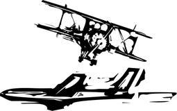 Träsnittflygplan Arkivfoto