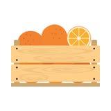Träspjällåda med apelsiner Arkivfoton