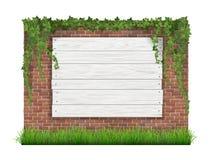 Trätecken på en gammal bakgrund för tegelstenvägg med grönt gräs och Royaltyfri Foto