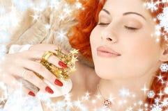 Träumen von Redhead mit weißes Weihnachtsglocken Stockbilder