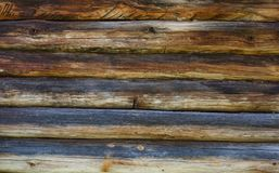 Trävägg från journaler som en bakgrundstextur arkivbild
