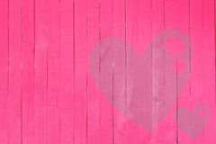 Träväggen med hjärta formade, valentindagbakgrund Royaltyfri Bild