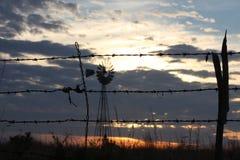 Tråd trä och, väderkvarn Arkivfoton