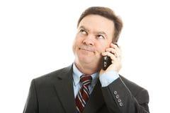 tråkig affärsmanfelanmälanstelefon fotografering för bildbyråer