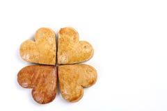 Trèfle à quatre feuilles de pain d'épice composé de quatre coeurs de pain d'épice Images stock