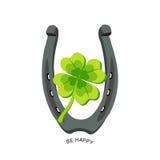 Trébol de la herradura y de cuatro hojas - el símbolo afortunado, sea feliz Foto de archivo libre de regalías