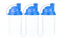 Três abanadores/esportes da proteína suplementam garrafas em um fundo branco Imagem de Stock Royalty Free