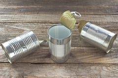 Três abrem a lata de lata vazia Imagens de Stock