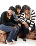 Três adolescentes felizes Imagem de Stock