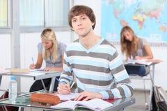 Três alunos na sala de aula Foto de Stock