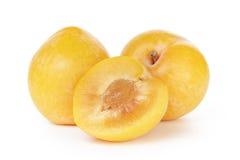 Três ameixas amarelas maduras Imagens de Stock Royalty Free