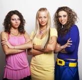 Três amigos de menina que sorriem junto Imagens de Stock